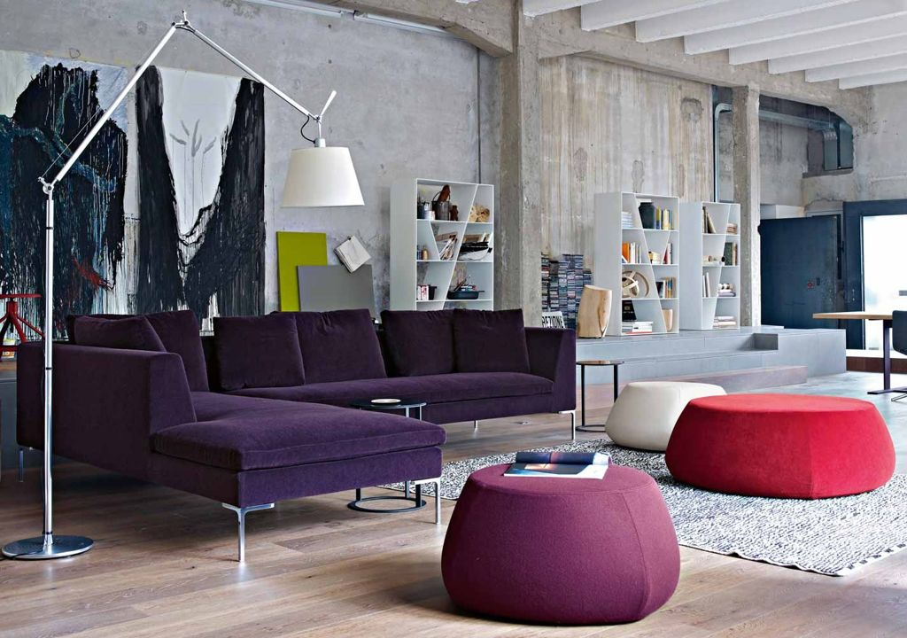 Dark purple l shaped sofa for open plan living room ideas with grey concrete wall plus decorative canvas wall paiting